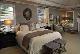 traditional master bedroom with round wall mirror by beckwith