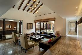 the living room is a double height space adorned with a