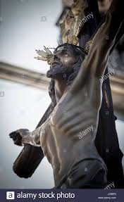 figure of jesus on the cross carved in wood by the sculptor gabino