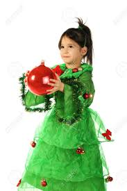 little smiling in green christmas tree costume with red