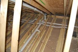 ducts buried in attic insulation and encapsulated building