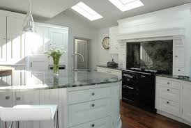 modern kitchen ideas with white cabinets gray granite countertop white wooden cabinets skylights modern