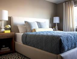 Beige Upholstered Bed White And Beige Bedroom With Blue Bedding Transitional Bedroom