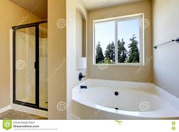 White And Beige Bathrooms Beige Bathroom Interior With White Bath Tub And Glass Shower Stock