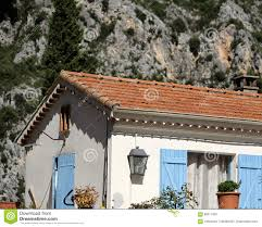 Small Cottage by Small Cottage With Blue Shutters Stock Photo Image 66511405