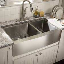 double silver stainless steel sink placed on the white wooden base