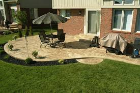 some backyard patio design ideas are a circular stone patio with