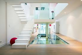 all white home interiors futuristic townhouse with central glass axis idesignarch