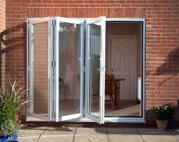 Bifold Patio Door by Kitchen Bi Fold Aluminum Patio Doors With Brick Wall The