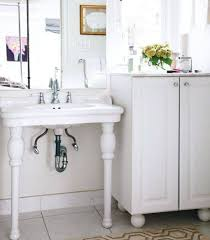 bathroom pedestal sinks with legs and mirror and cabinet