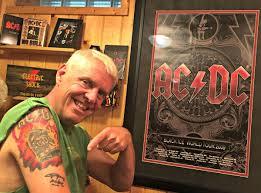 acdc tattoo a dream come true u0027 q c musician gets ac dc u0027s angus young