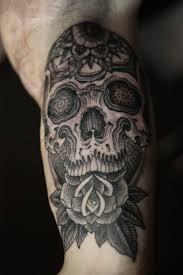 black skull in the esoteric style skull tattoos