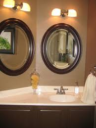 Guest Bathrooms Ideas by White Single Pedestal Sink On Brown Mosaic Marble Bathroom Floor