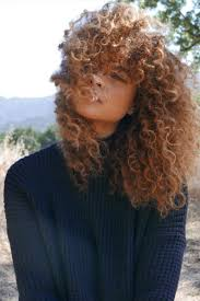 long curly hair style for lawyer medium length hairstyles we re loving right now southern living