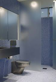 frosted glass interior doors for bathrooms with blue wall mosaic