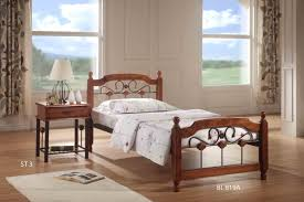 single classic wood bed with iron headboard design as well as