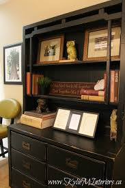 ideas to accessorize a black painted and distressed bookcase or