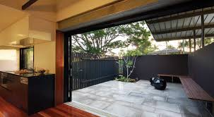 small courtyard garden with long wooden seating for chic look