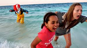 scary killer clown attacks kids on the beach scary clown chase