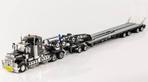 kenworth 2016 models t909 truck with 2x8 dolly 4x8 swingwing trailer kenworth t909
