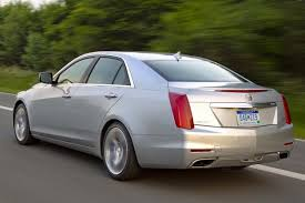 cadillac xts vs cts 2014 cadillac cts vs 2014 mercedes e class which is better
