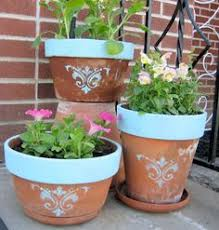 Home Depot Plastic Planters by Just A Little Spray Paint And A Stencil Yard Stuff Pinterest