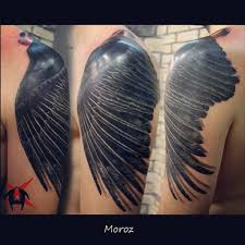 crow wings tattoo pictures to pin on pinterest tattooskid