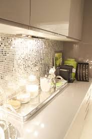 cream and gray kitchen with reflective backsplash this is just