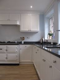 bespoke kitchen finished in satin white with blue pearl granite