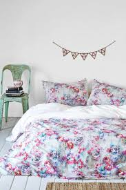 stylish plum and bow bedding homesfeed red blue white plum and bow bedding with green chair with books