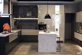marble breakfast bar black pendant lights electric cooktop dark
