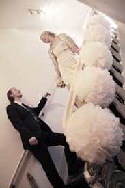 decorate banisters stairs with large pom poms for a