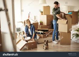 young couple new apartment small dog stock photo 547444582
