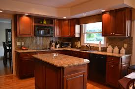 l shaped brown polished wooden kitchen cabinet and kitchen island