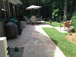 belgard paver tile overlay expands existing concrete patio in