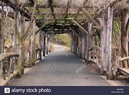 rustic park walkway through arbor trellis in prospect park
