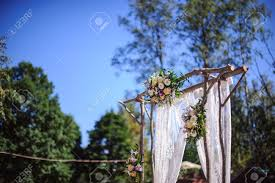 wedding arches made of branches wedding arch made of wood decorated with flowers stock photo