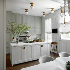 gray shaker kitchen cabinets with brass inset hardware