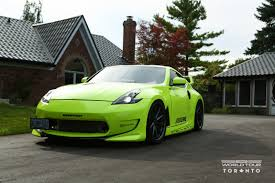 nissan green visual styling tweaks on neon green nissan 370z fitted with vossen
