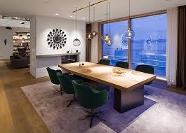 multi pendant lighting adorns lakeside home in germany