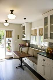 best 25 narrow kitchen island ideas on pinterest small island kitchen breakfast nooks with no room for a large eat in area this galley kitchen maximizes space with a built in bench and super slim dining table