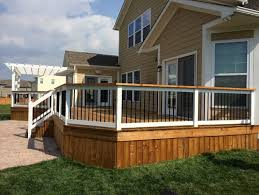beautifully stained two tone deck white pergola railing and