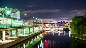 flowing water canal and bridge at night time lapse stockholm city