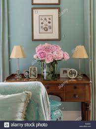 Pink Peonies Bedroom - pink peonies on antique dressing table with framed photos and