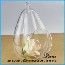 glass terrarium with snowy flower hanging terrarium table