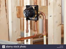 plumbing for a new home the copper pipes for bathtub faucet stock