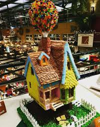 this up themed gingerbread house is totally the stuff of dreams