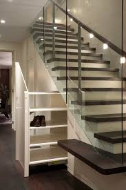 under porch storage with under stairs doors staircase contemporary