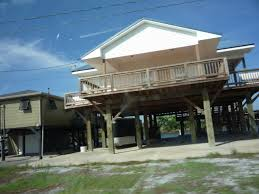 file cocodrie louisiana houses on stilts jpg wikimedia commons