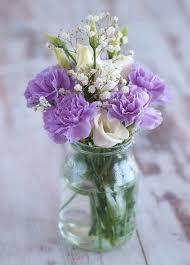jar arrangements simple purple floral centerpiece idea in a jar flowers